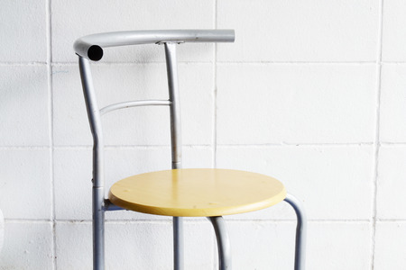 white wall: chair on white wall Stock Photo