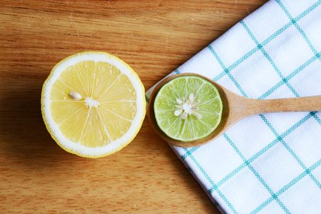 dring: lime and lemon halves on wooden table