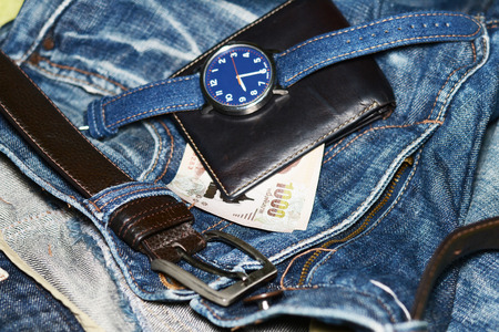 blue denim: Blue denim jeans and leather wallet