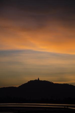 puget: Phuket big Buddhaon hill top with sun set, Stock Photo