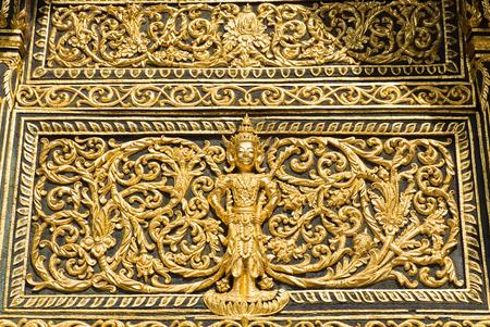 pediment: Close up of pediment of temple above the entrance of buddhist sanctuary