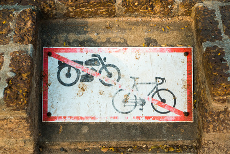 old sign: No motorcycle sign and no bicycle sign on brick old wall background Stock Photo