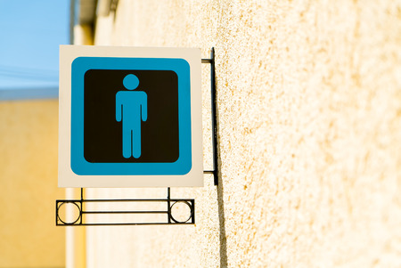 public restroom: Public restroom signs with a gentleman symbol