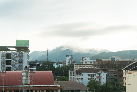 yai: View of Hat Yai city with fog cover the mountain in the background Stock Photo
