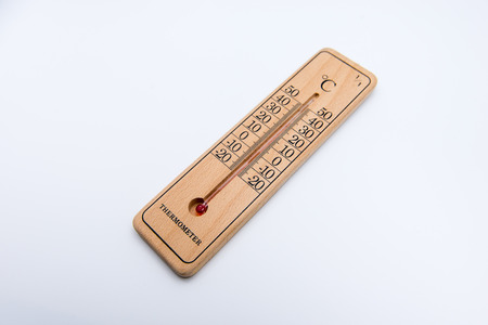 Wooden thermometer isolated on white background. Selective focus