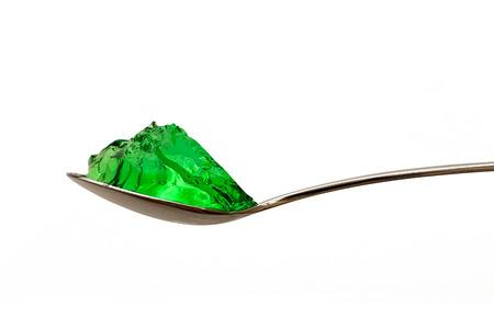 grenn jello on teaspoon isolated