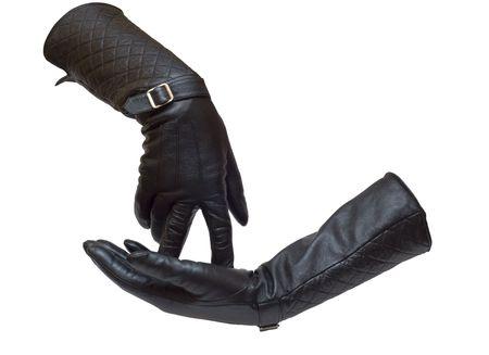 threw: Two leather female gloves nobody Stock Photo