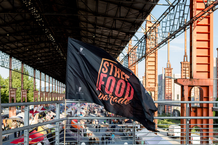 dora: TURIN, ITALY -JULY  01 2016: flag and view of the Street Food parade in Parco Dora park, Turin, Italy Editorial