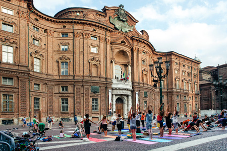 TURIN,ITALY,JULY 11,2012: Yoga flash mob in piazza Carignano, Turin, Italy