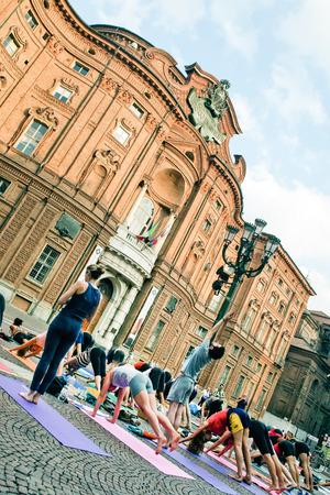 risorgimento: TURIN,ITALY,JULY 11,2012: Yoga flash mob in piazza Carignano, Turin, Italy