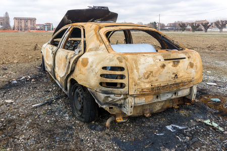 Abandoned burnt down car after an explosion, ready to be scrapped.