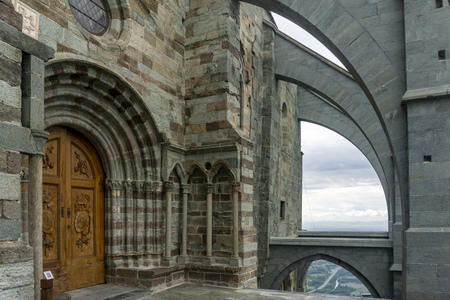 The Church door of the The Sacra di San Michele, also known as Saint Michaels Abbey, is a religious complex on Mount Pirchiriano, situated on the south side of the Val di Susa