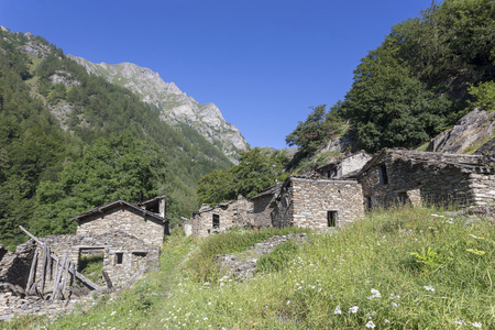 mountain architecture. abandoned village in alps mountains full of different houses and destroyed buildings. Piedmont. Italy