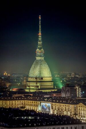 Scenic night cityscape of Turin with the Mole Antonelliana and Vittorio square lighted for the new year celebrations. Italy Standard-Bild