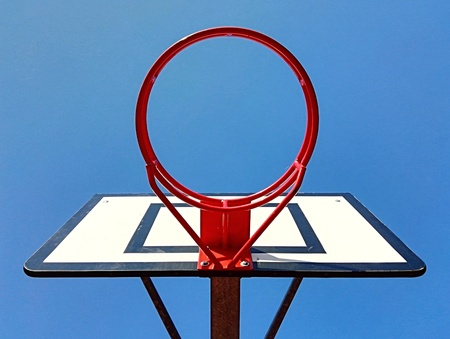 Red basketball hoop and blue sky