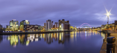 A Panorama of Newcastle upon Tynes River Tyne showing Newcastle and Gatesheads Quayside with the Millennium and Tyne Bridge, Northeast.