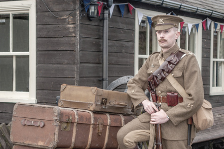 ww1: Tanfield, UK, March 12, 2016: Reenactors WW1 weekend. A reenactor waits for a steam train at Andrews House station, Tanfield Railway, the oldest railway in the world.