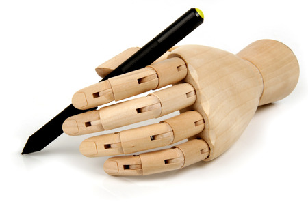 bendable: wooden dummy pen hand with isolated background