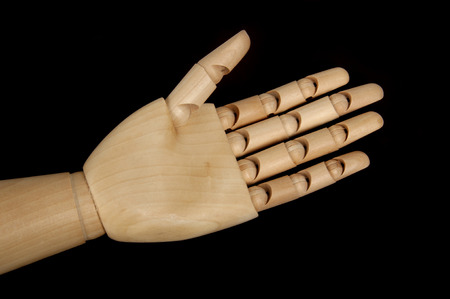 bendable: wooden dummy help hand with black background Stock Photo