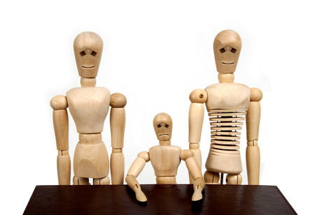 wooden mannequin: wooden dummy family with isolated background