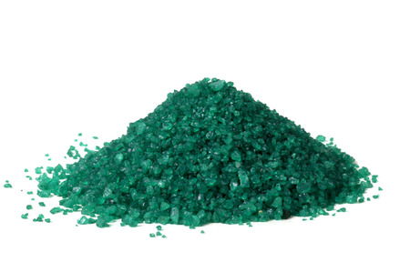 Pile of green colour sand with isolated background photo