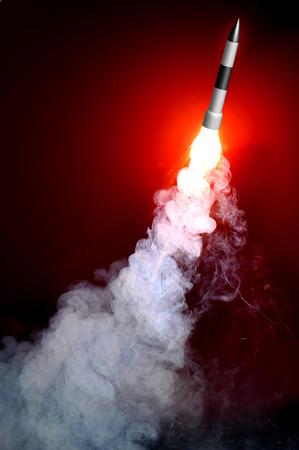 closeup shot on rocket launch with dark background photo