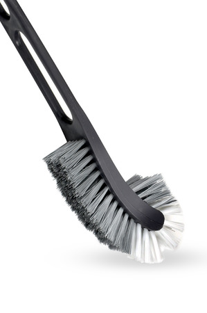 bright housekeeping: closeup shot on toilet brush with white background