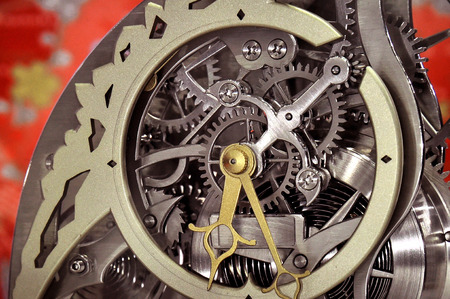 escapement: closeup shot on clock machine escapement gears