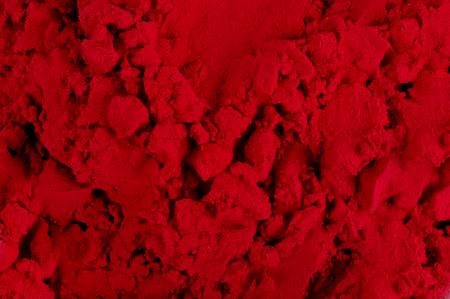 dark red: closeup shot on dark red color Powder