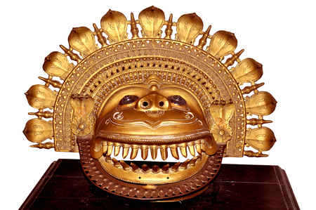 esoterics: indian metal handicraft sun god mask Stock Photo