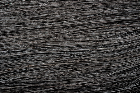 flaxen: camera shot on dark black hair texture background