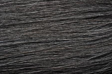 textura pelo: captura de cámara en fondo de la textura del pelo negro oscuro Foto de archivo
