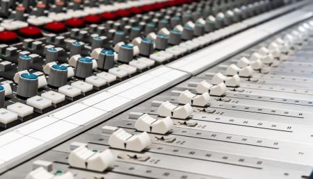 Professional mixer in recording studio photo