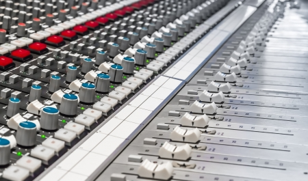 Professional mixer in recording studio photo