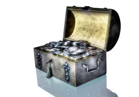 treasure trove: An old trunk with a small treasure trove of old silver coins in a fantasy atmosphere