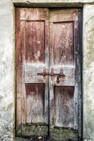 The door of an old abandoned medieval farmhouse in the Tuscan countryside  Italy   photo