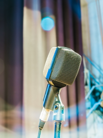 live performance: The old microphone waiting for the live performance of the singer for the next show  Stock Photo