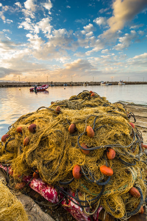 commercial fishing net: A fishing net in a small port in western Sicily (Italy)