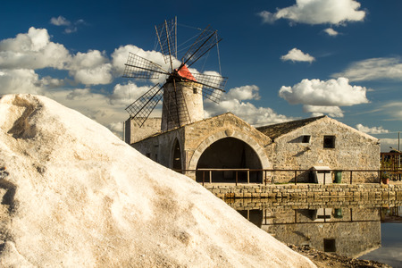 The salt pans of Nubia near Trapani (Sicily). The salt marshes are an important industry for the area and a strong tourist attraction Stock Photo