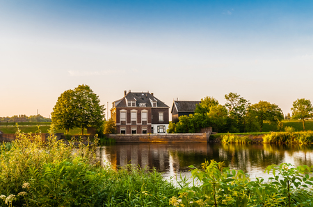 dutch typical: Dutch rural landscape with typical homes Stock Photo