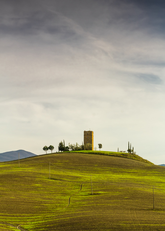 A landscape of the Val DOrcia in Tuscany with one of the many ancient towers in this area.