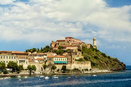 identifies: The lighthouse of Portoferraio that identifies the entry in the main port of the island of Elba (Tuscany, Italy)