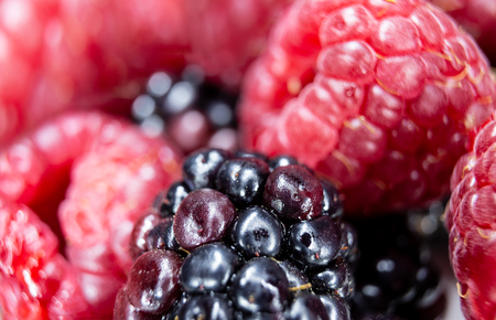 Close-up of raspberries and blackberries, it is a good and fresh fruit that is very healthy and contains few sugars.