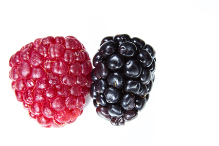 Closeup of a blackberry and a raspberry, a seasonal fruit, a prelude to summer Stock Photo