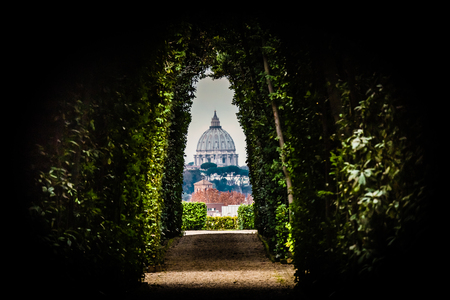 A particular view of the dome of St. Peter (Vatican City - Rome). Continuing after the Giardino degli Aranci, at Piazza Cavalieri di Malta there is the Villa del Priorato of Malta and from this place you can admire this particular view