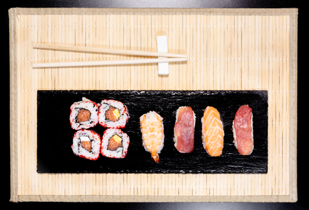 Sushi, a typical Japanese food prepared with a base of rice and various raw fish such as tuna, salmon, shrimp and sea bream. To which is added, according to the variants. It can be accompanied by soy sauce. Stock Photo