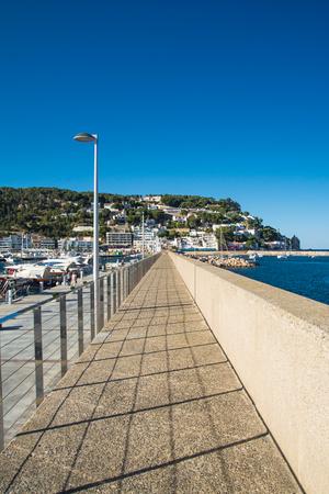 Walk at LEstartit port on a sunny day Stock Photo