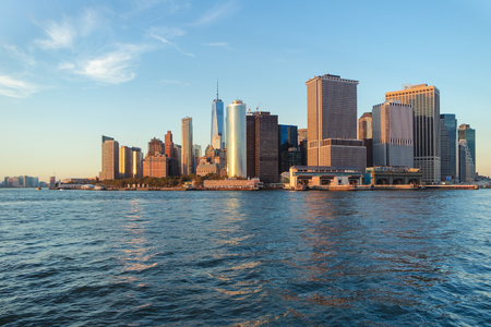 Horizontal view of Manhattan from the Hudson river at sunset