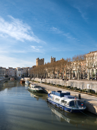 Boats on the Robine Canal in the center of Narbonne on a sunny winter day