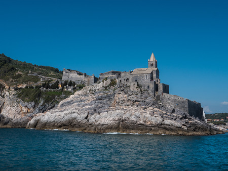 view from the sea of the Church of Saint Peter in Porto Venere on a sunny day